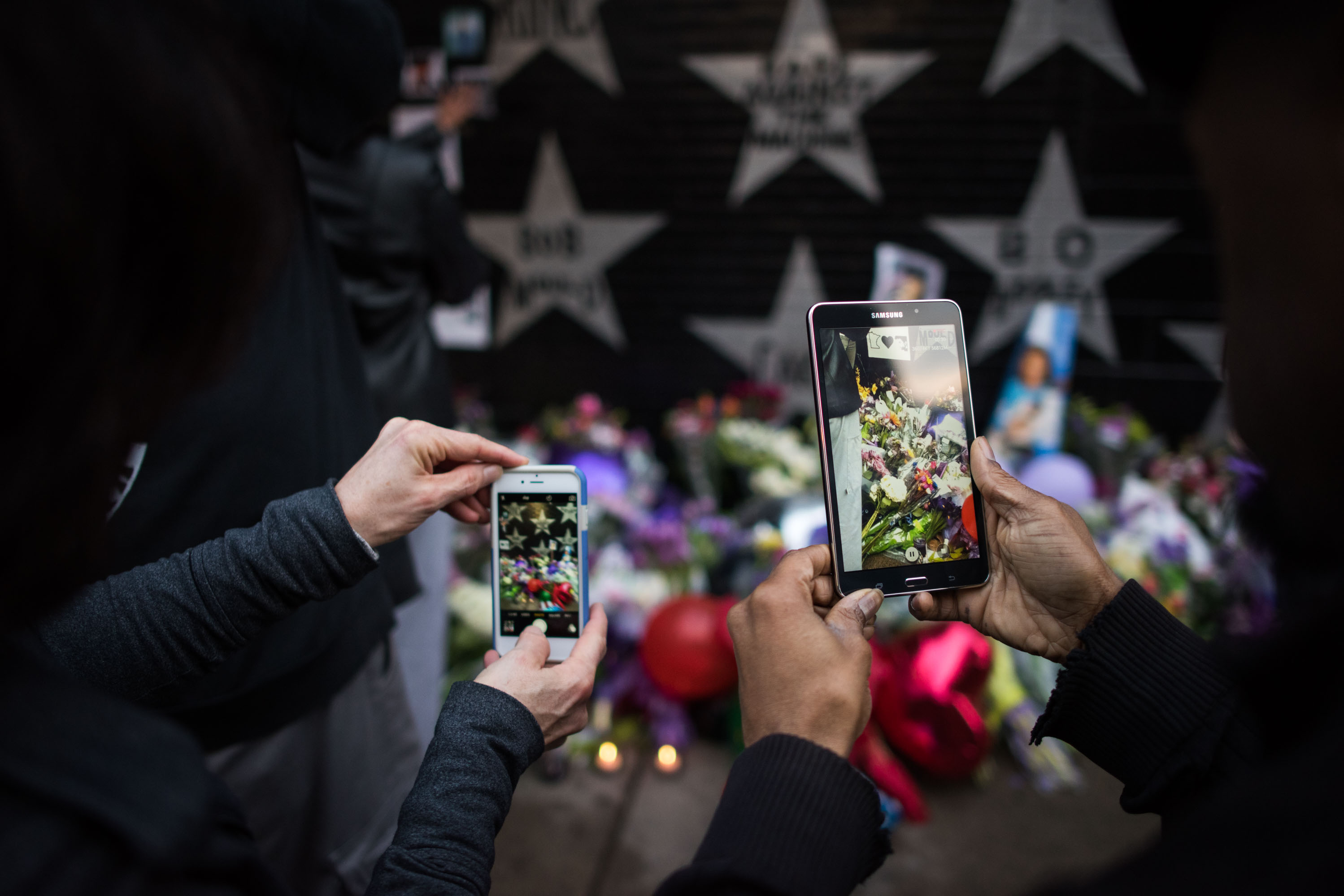Fans take photos of the improntu memorial to Prince outside of First Ave in downtown Minneapolis. April 21st, 2016.
